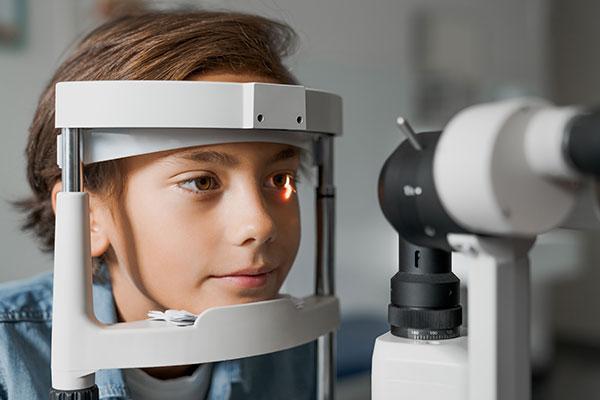 young boy eye exam